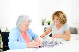 caregiver helping to reduce agitation with dementia patient