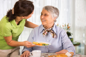Lutherville home care provider preparing meal for senior client