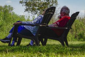 caregiver sitting with elderly man