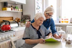 caregiver helping elderly woman