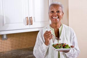 senior-woman-eating-salad