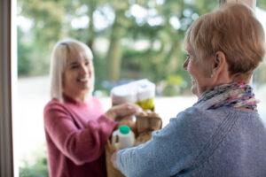 caregiver-visiting-senior-woman